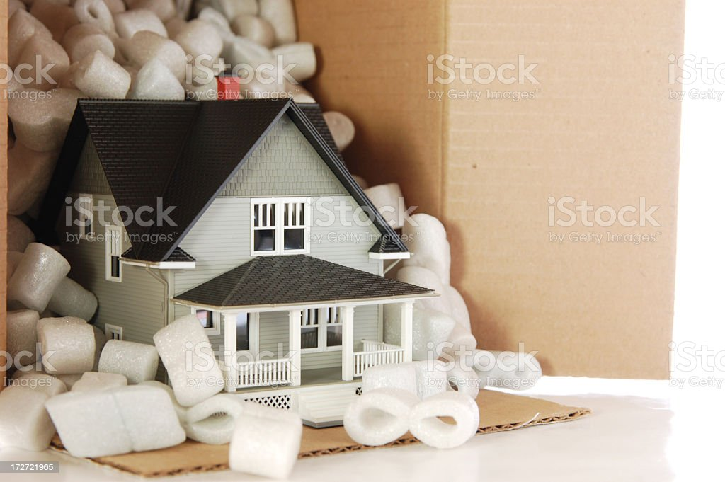 Moving concept of a small house with little white things royalty-free stock photo