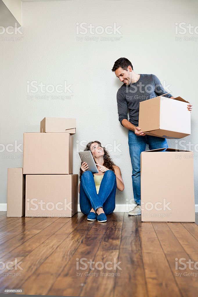 Moving Couple with Tablet stock photo