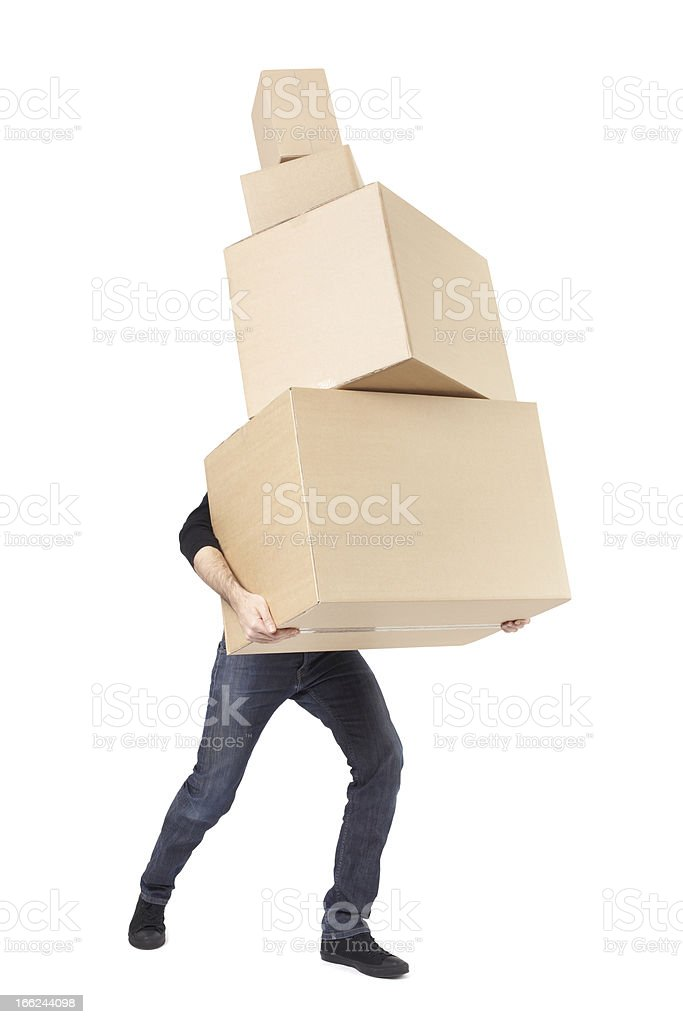 Moving day, man lifting cardboard boxes stack stock photo