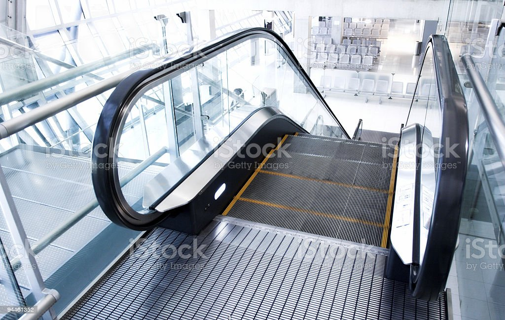 A moving escalator going downstairs royalty-free stock photo