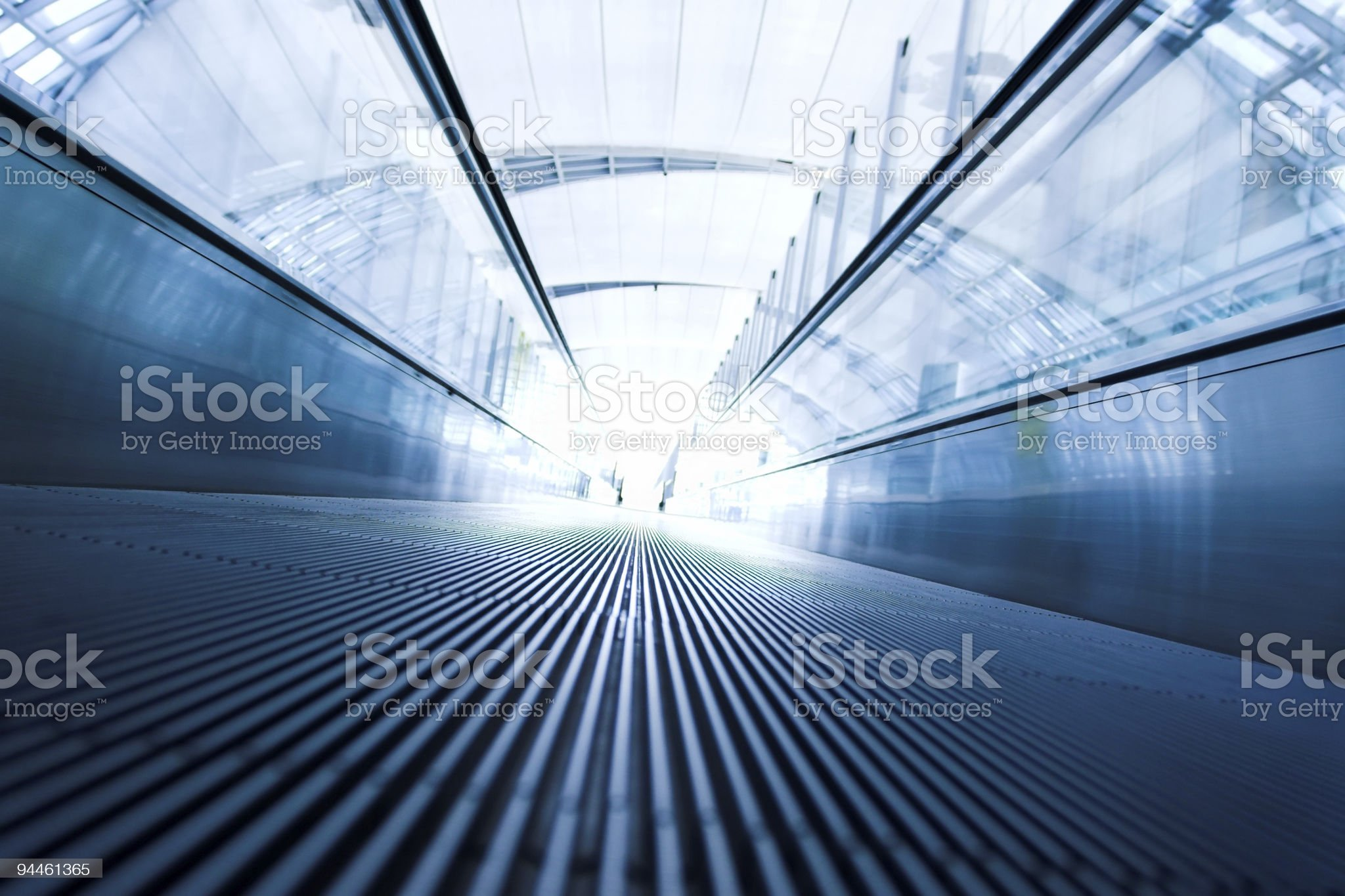 Moving escalator in office hallway royalty-free stock photo