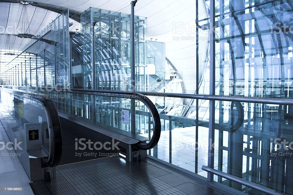 moving  escalator in the office hall royalty-free stock photo