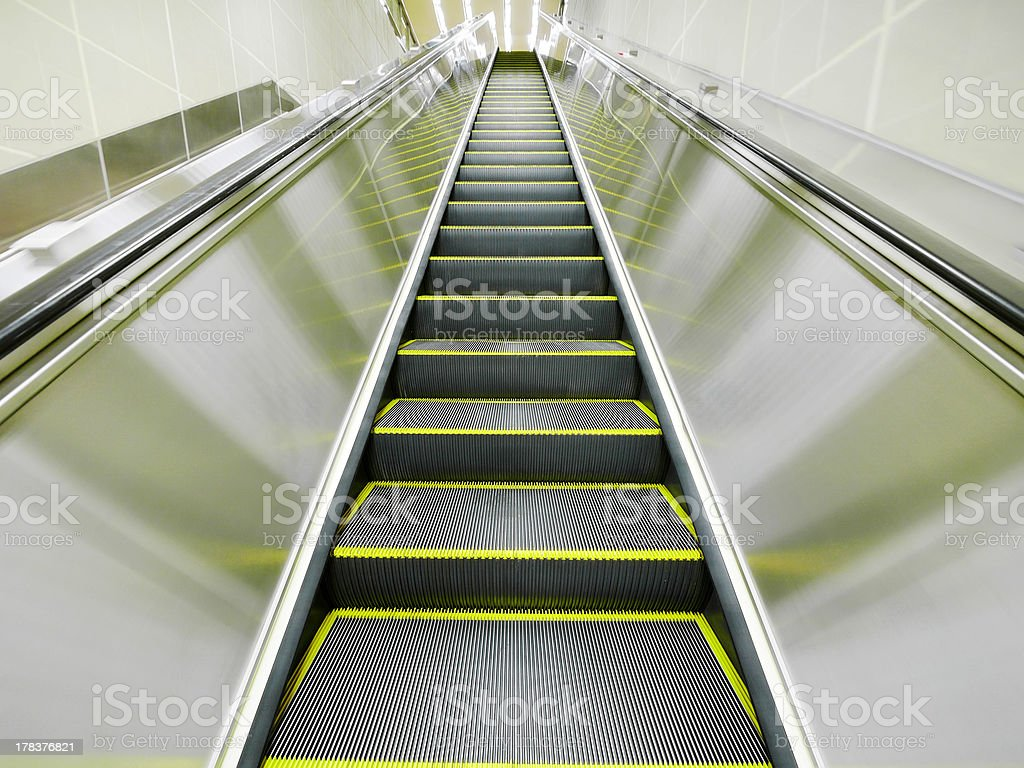 Moving escalator royalty-free stock photo