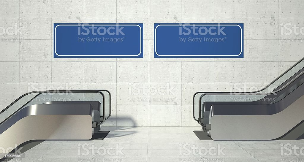 Moving escalator stairs and blank advertising billboard royalty-free stock photo
