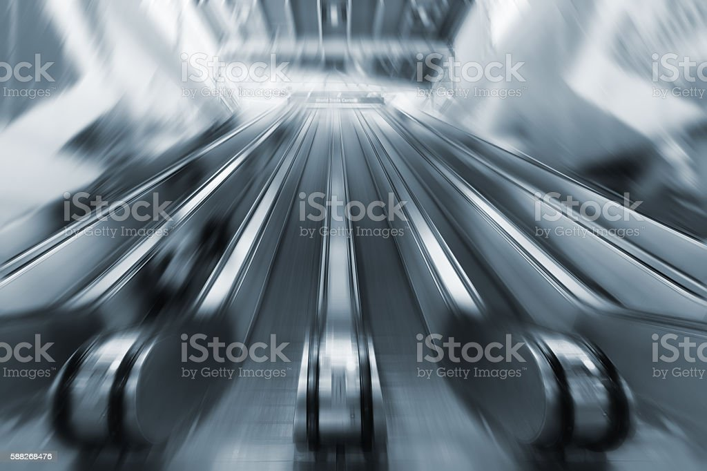 Moving escalators in the business center stock photo