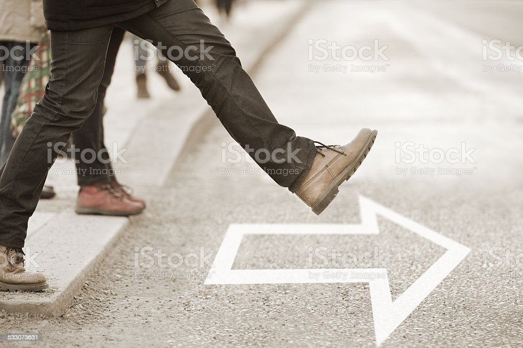 Moving forward, daring to take the step stock photo