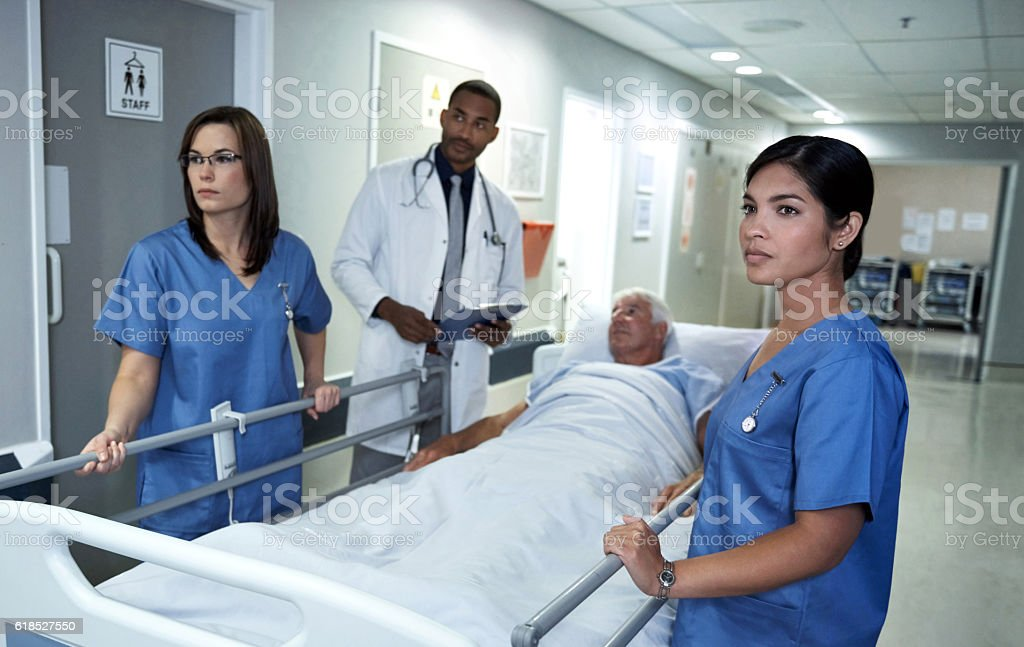 Moving him to a private ward stock photo
