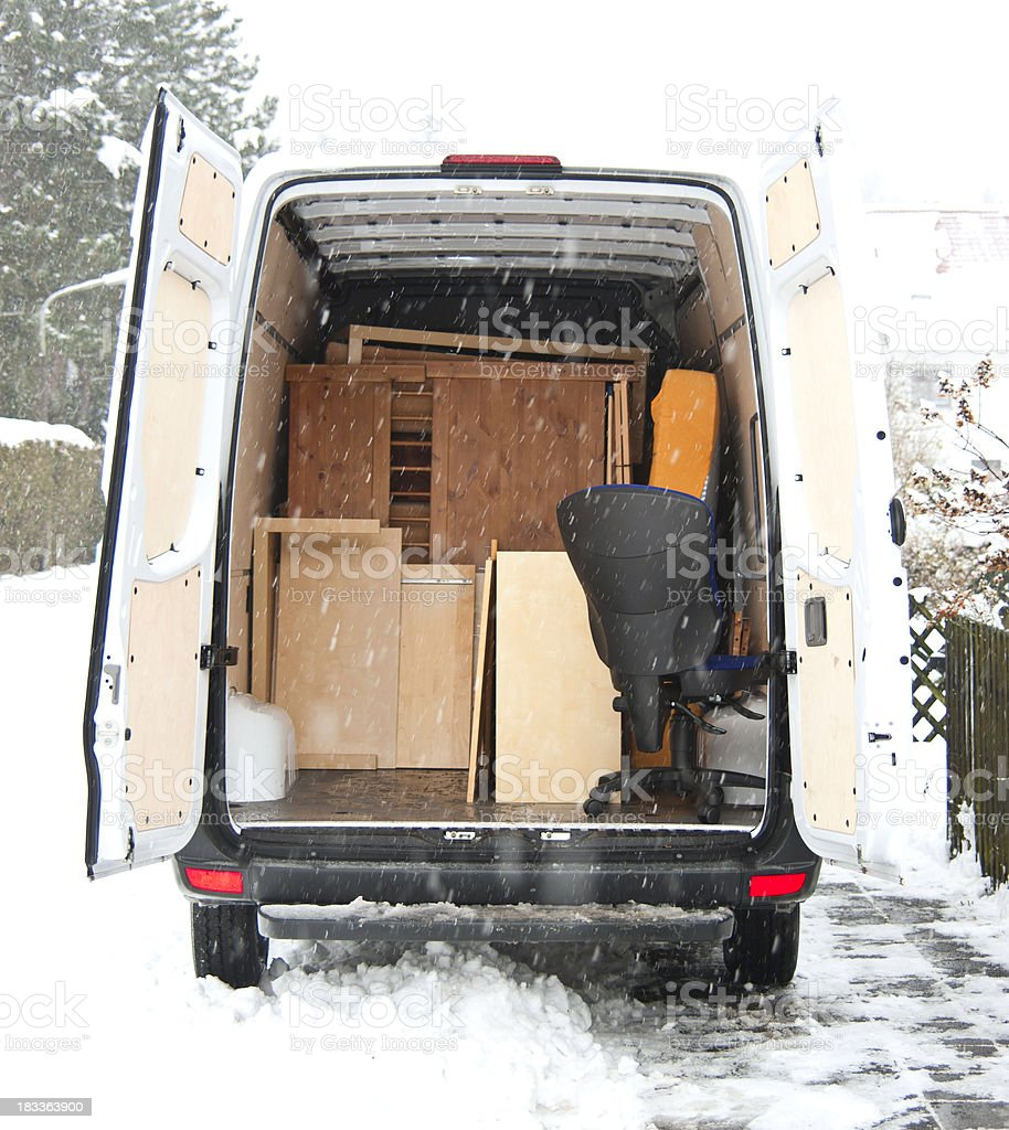 moving home at winter - Umzugswagen Sprinter stock photo