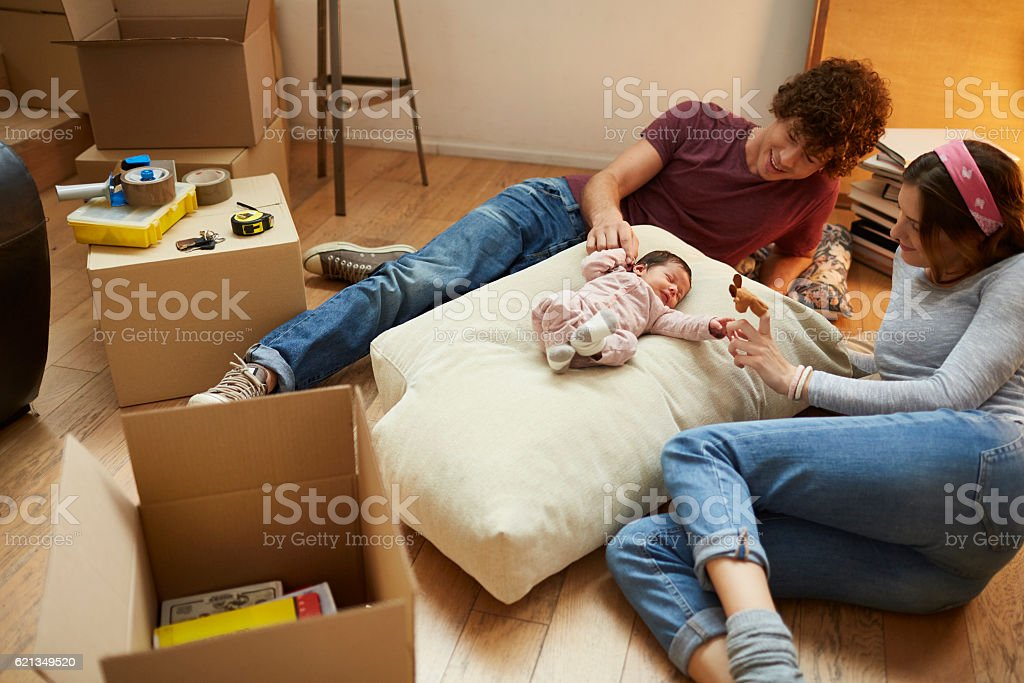 Moving home new beginnings. Realaxing with baby. stock photo