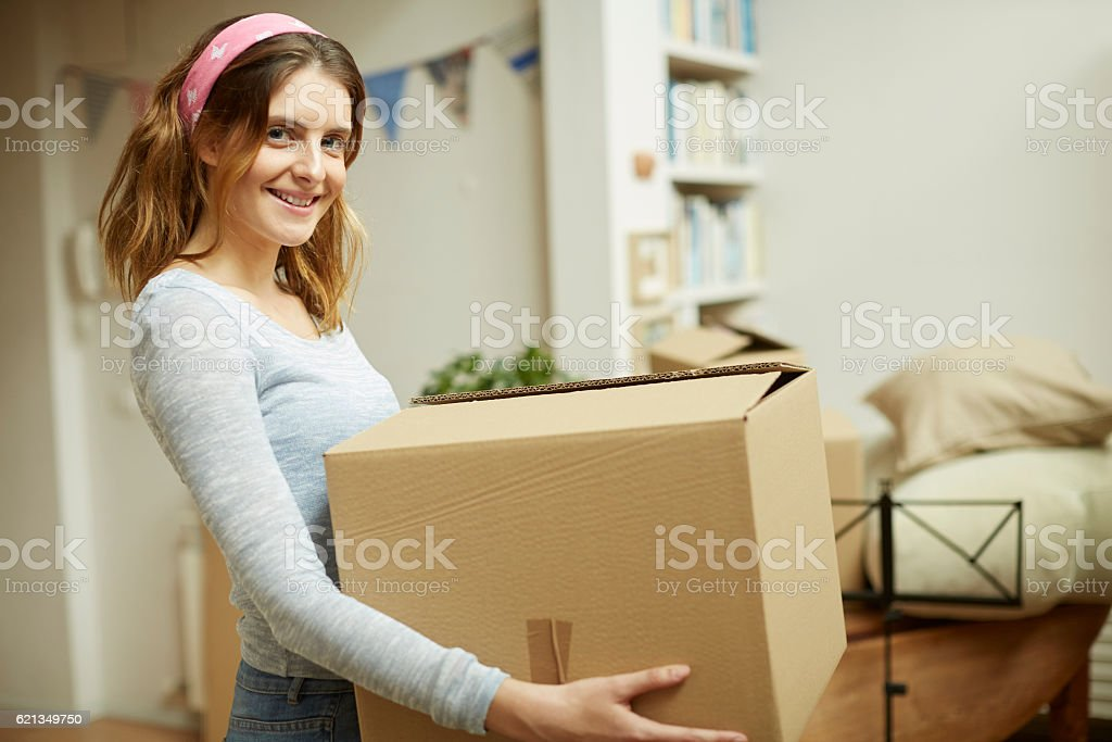 Moving home new beginnings. Smiling at camera. stock photo