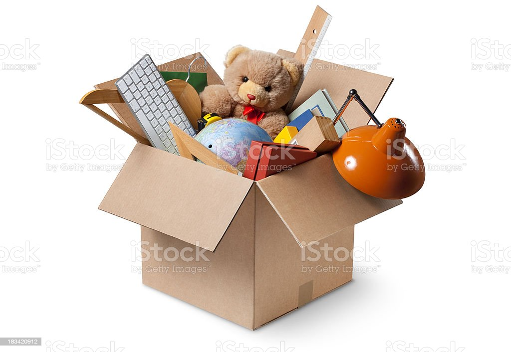 Moving house. Cardboard box with various objects. stock photo