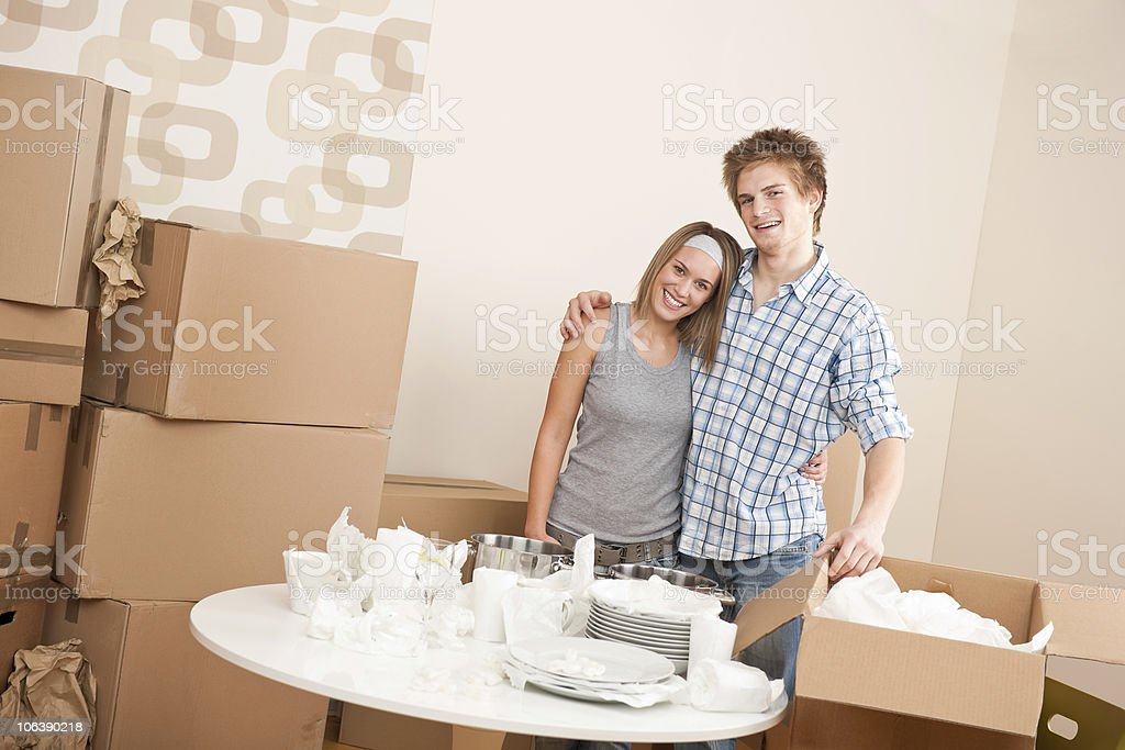 Moving house: Happy man and woman with box royalty-free stock photo