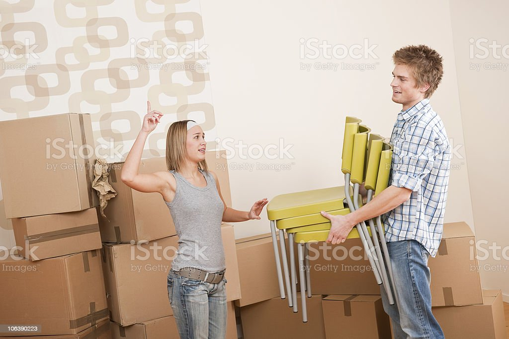 Moving house: Man and woman with box royalty-free stock photo