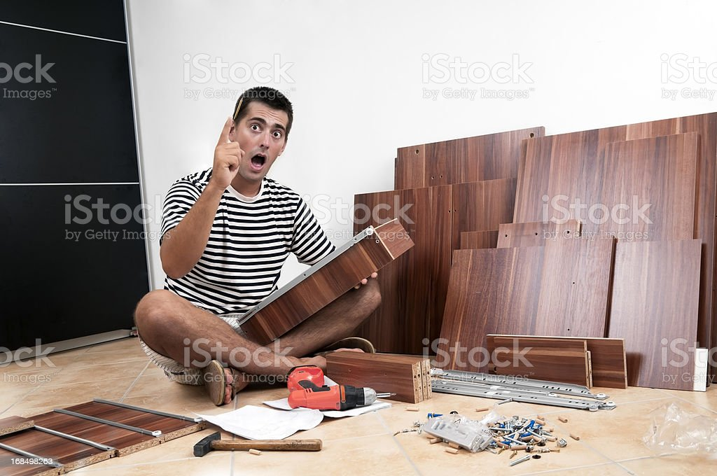 Moving in, furniture assembly stock photo