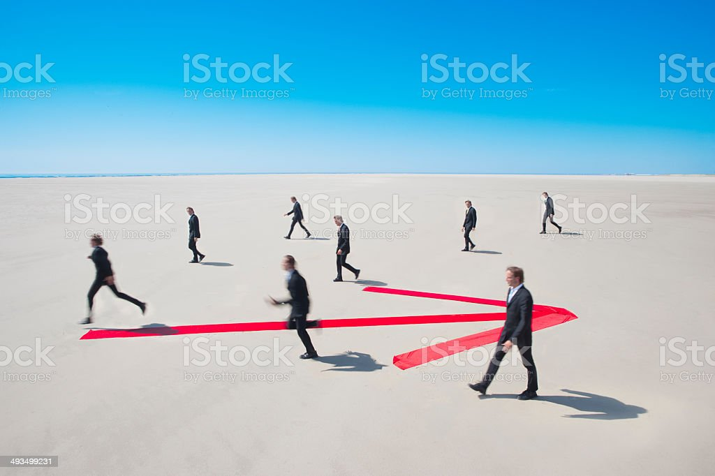 Moving in opposite direction stock photo