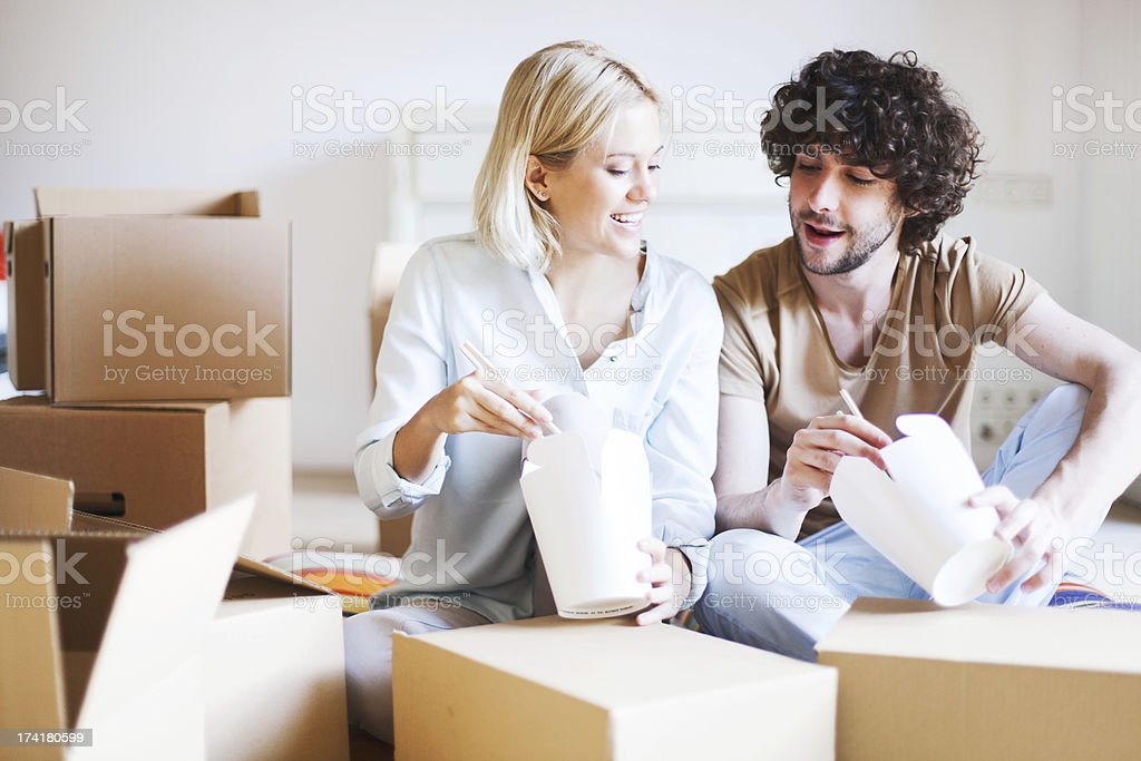 Moving into a new home and eating takaway. stock photo