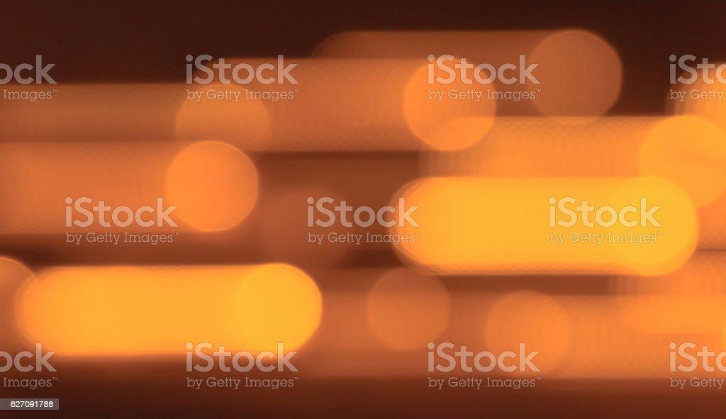Moving orange lights. Blurred orange background. stock photo