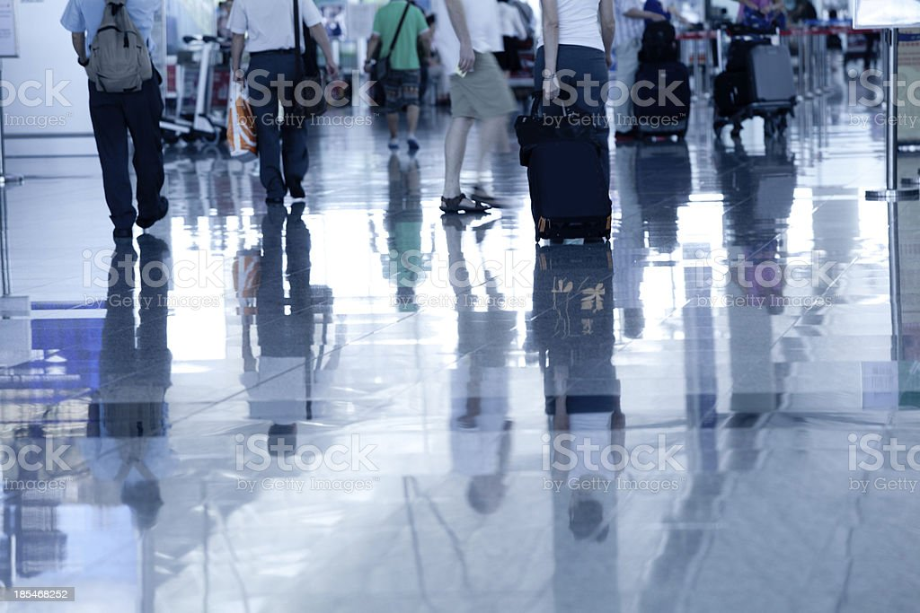 moving people at airport royalty-free stock photo