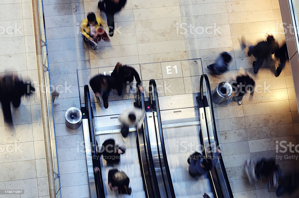 moving people in a mall royalty-free stock photo