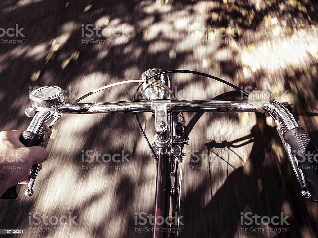 Moving picture of a bicycle on an asphalt road royalty-free stock photo