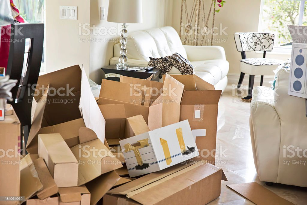 Moving Series: Empty boxes to be packed to move stock photo