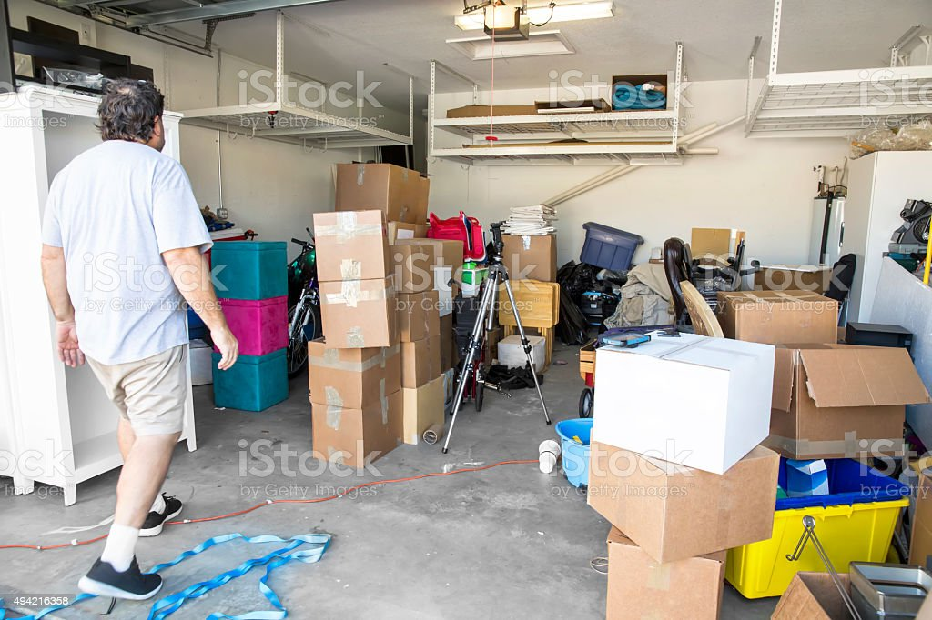 Moving Series: Mover in garage with items to be moved stock photo