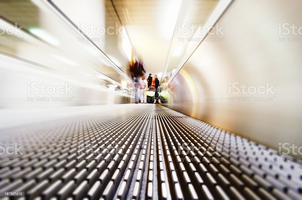 Moving stairway and passengers stock photo