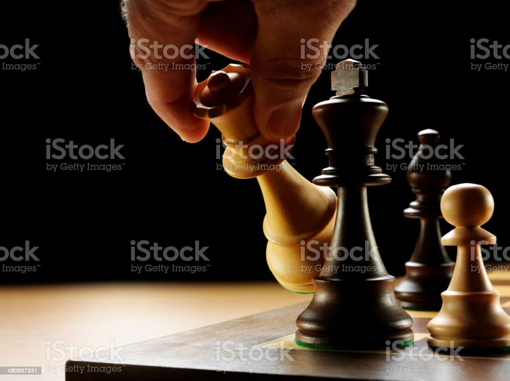Moving the Queen Chess Piece in a Board Game royalty-free stock photo