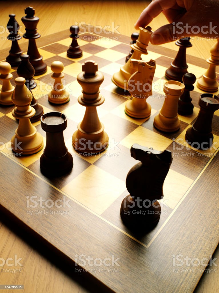 Moving the Queen Chess Piece in a Game royalty-free stock photo
