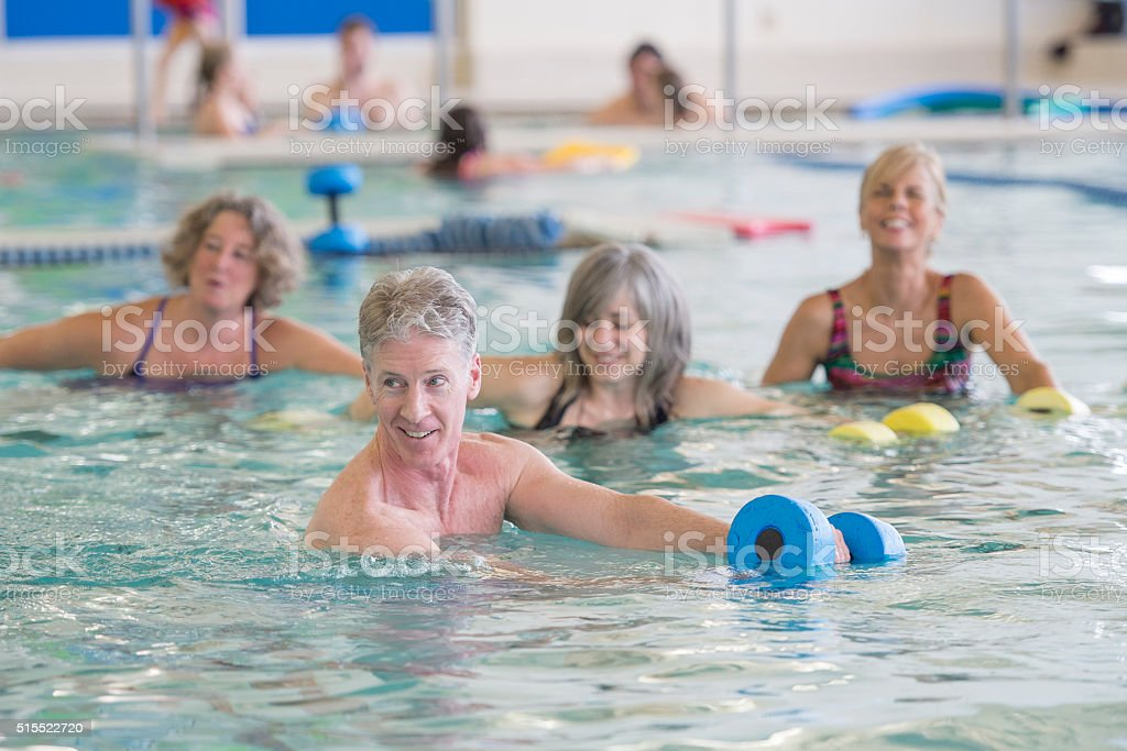 Moving Through the Water in a Fitness Class stock photo