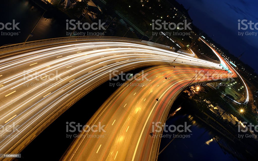 Moving traffic on freeway highway at night blurry speed stock photo