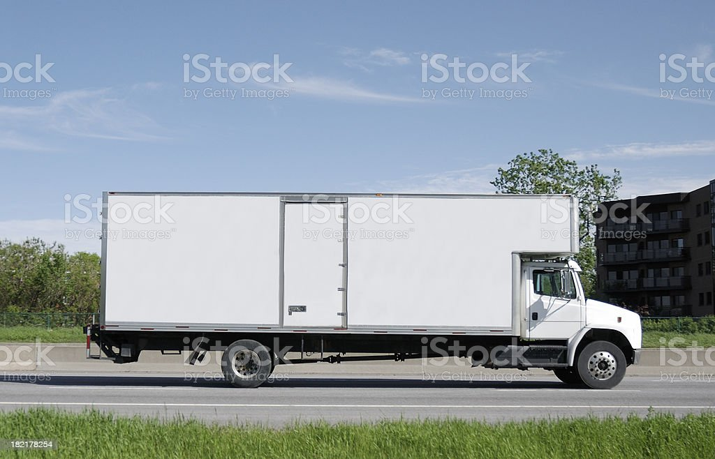 Moving truck on road. stock photo