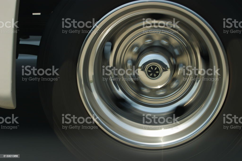 Moving vehicle tire stock photo