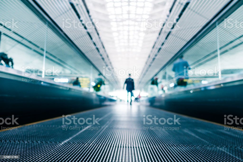 Moving walkway in motion blur stock photo
