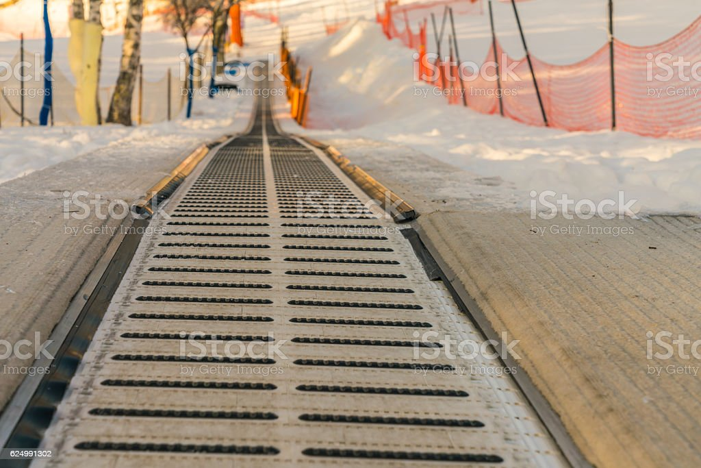 Moving walkway in snow stock photo