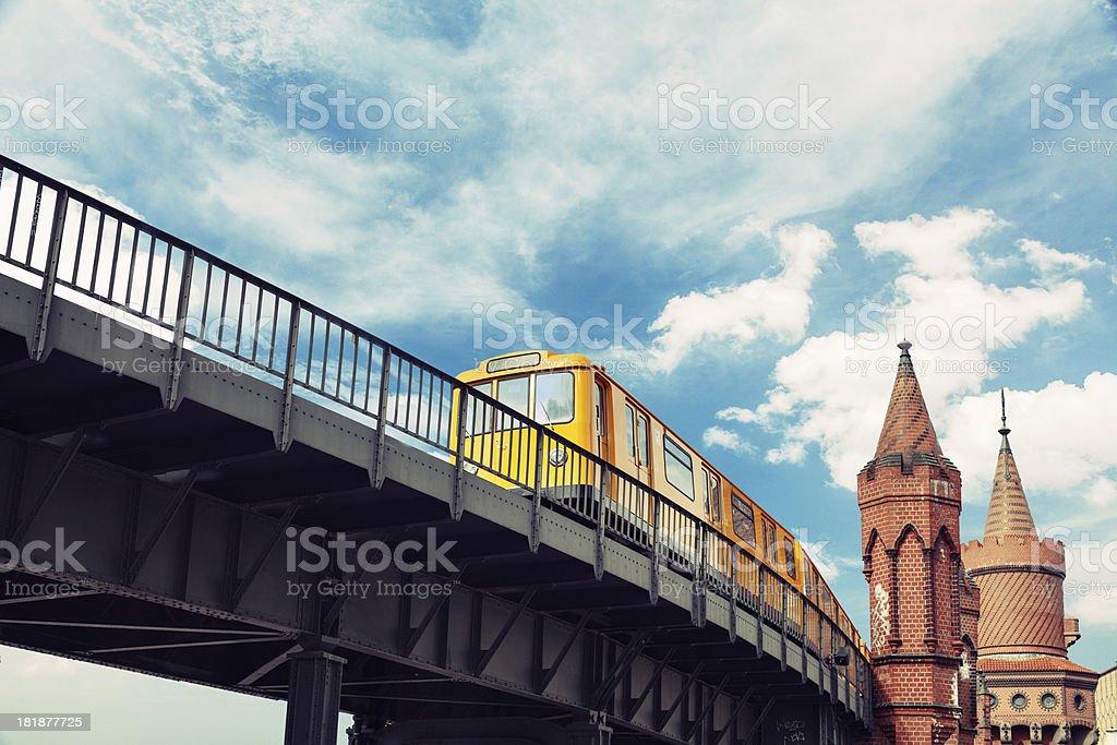 Moving yellow train in Kreuzberg U-bahn in Berlin stock photo