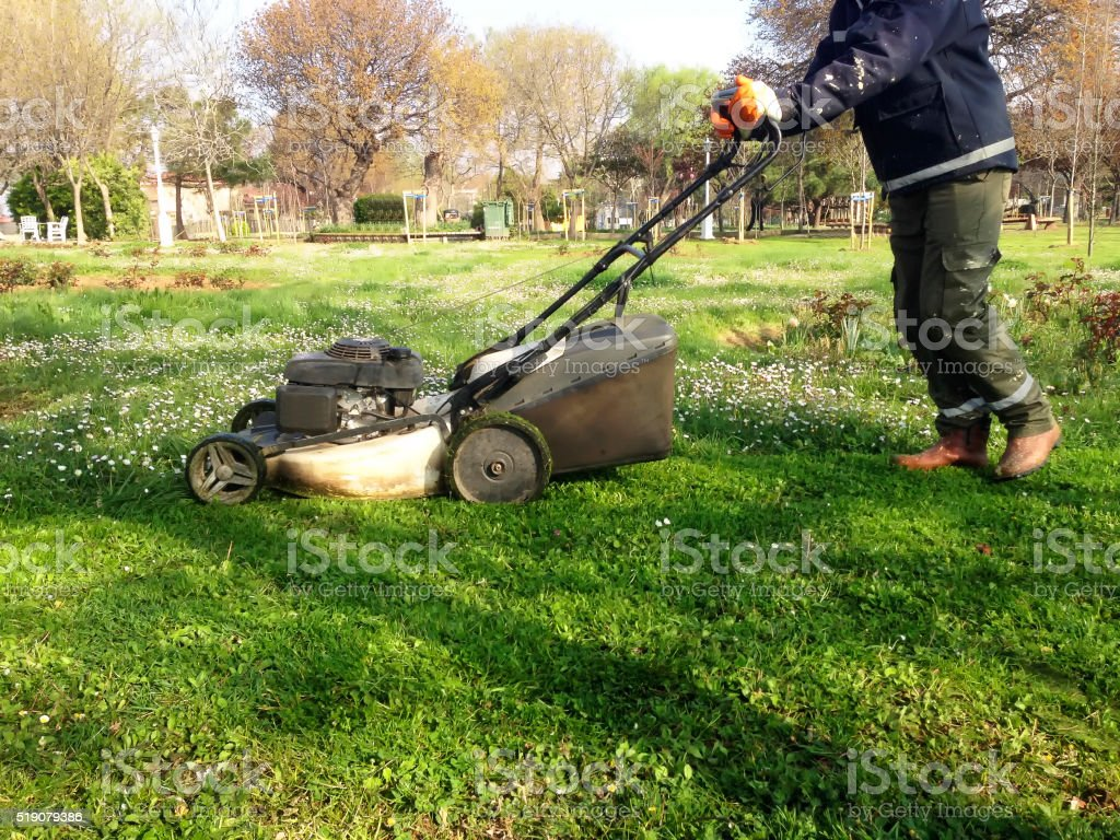 Mowing lawn with machine stock photo