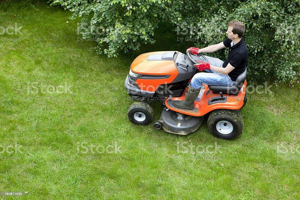 Mowing Lawn With Ride On Mower stock photo