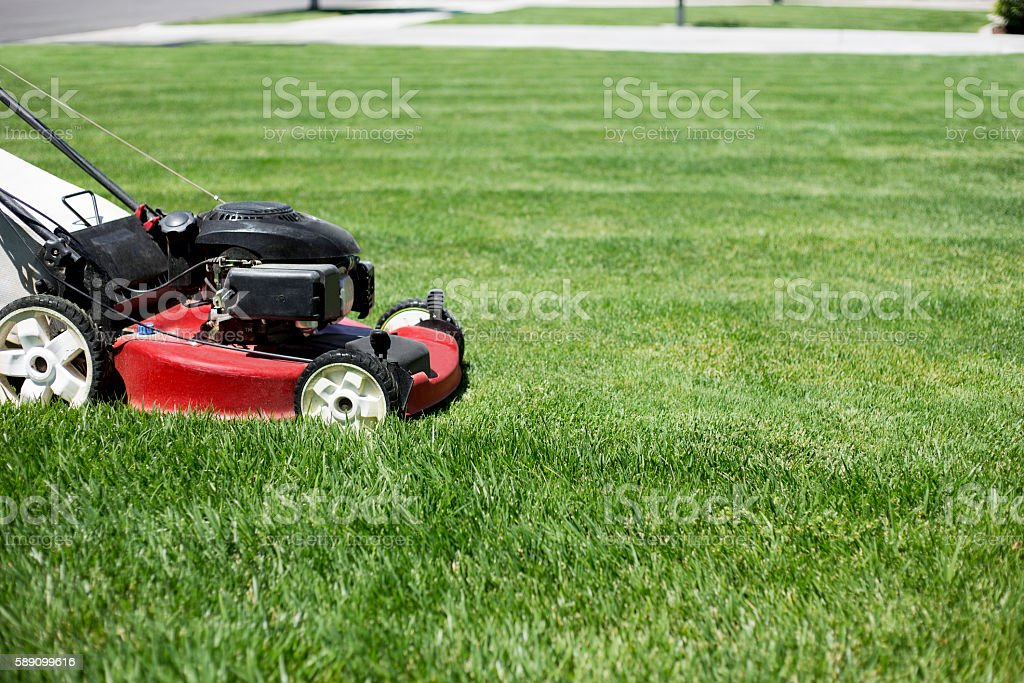 Mowing the lawn outdoors stock photo