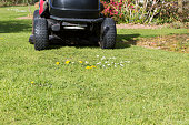 Mowing the lawn with tractor