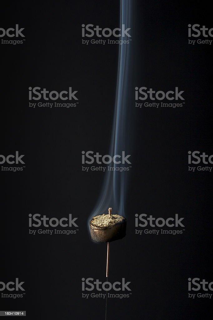 Moxa burning on needle stock photo