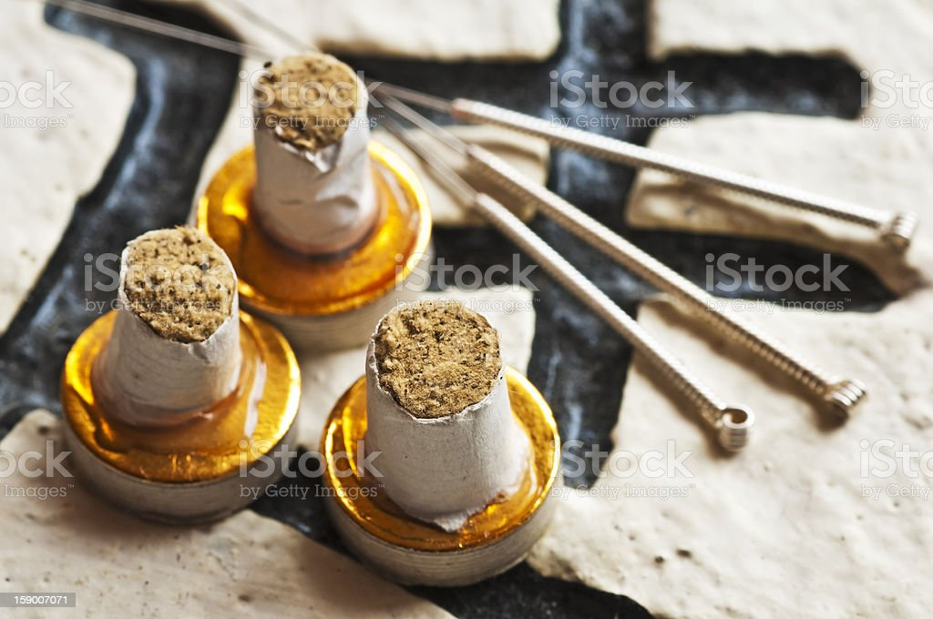 Moxa cones and acupuncture needles stock photo