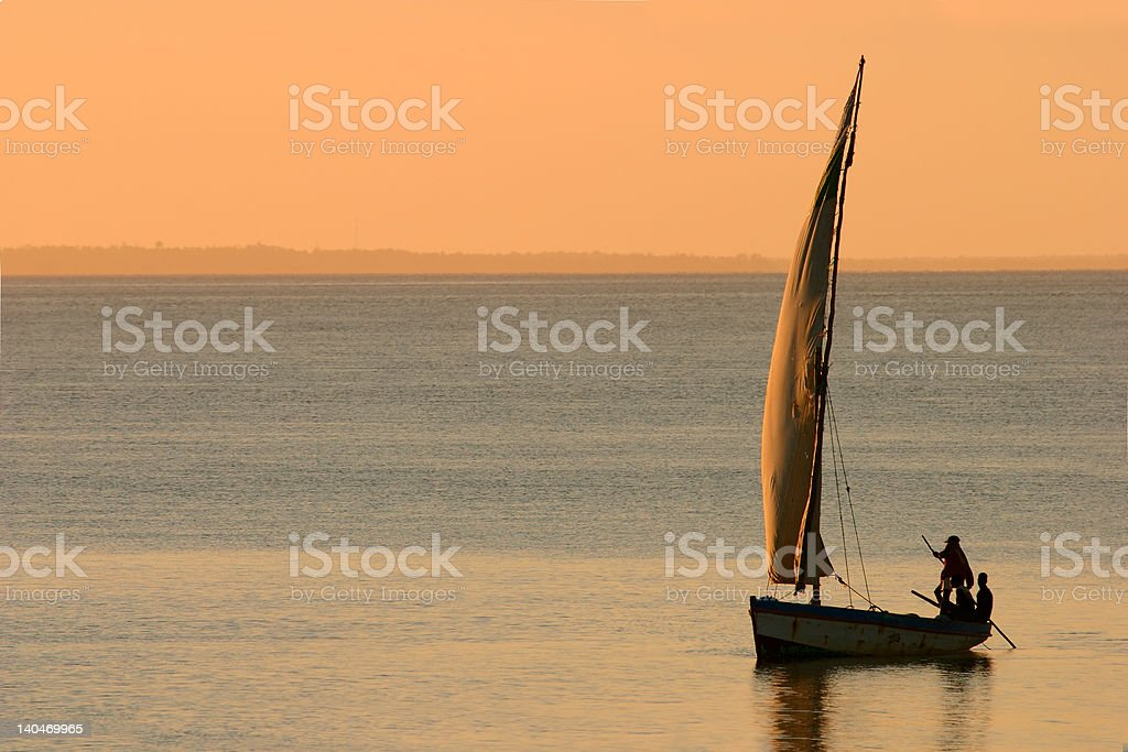 Mozambican dhow at sunset stock photo