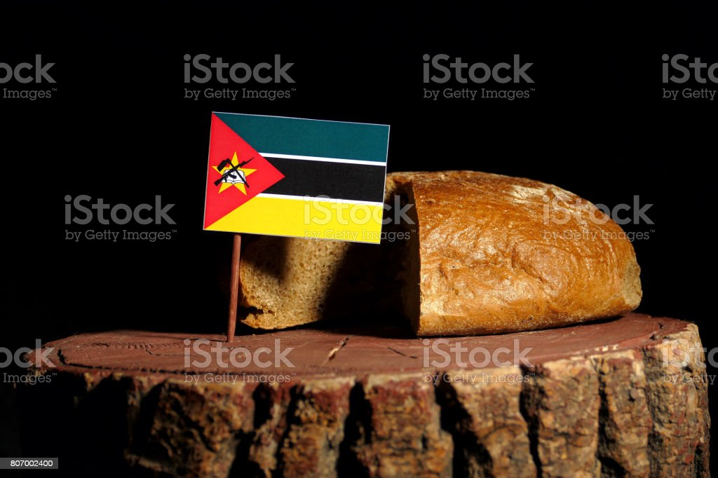 Mozambique flag on a stump with bread isolated stock photo