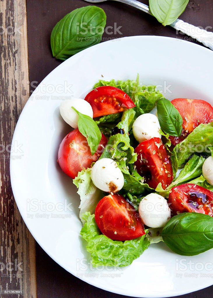 Mozarella and Tomato Salad with Basil and Lettuce stock photo
