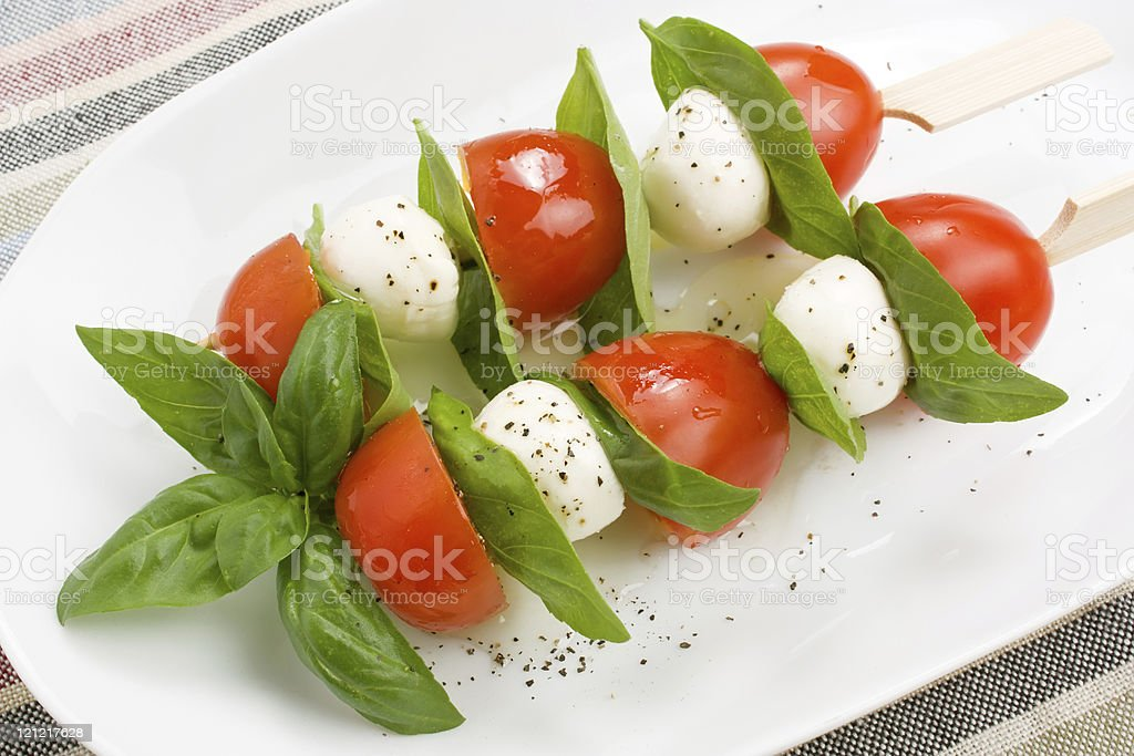 Mozzarella, basil and cherry tomato royalty-free stock photo