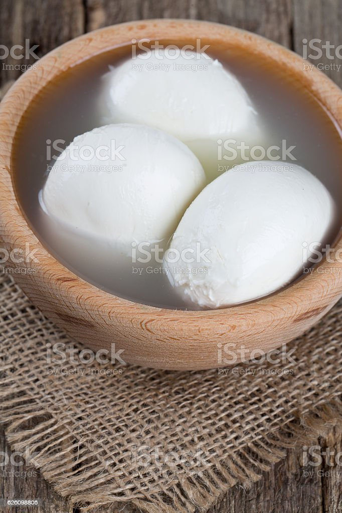 mozzarella cheese on wooden table stock photo
