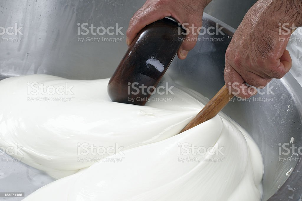 mozzarella cheese prodution stock photo