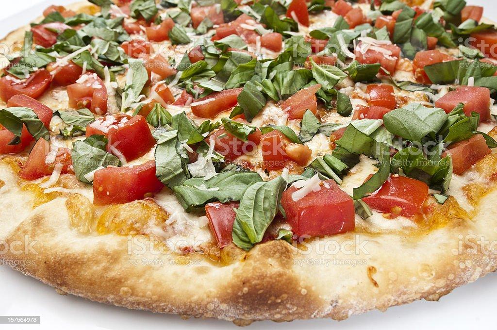 Mozzarella, diced tomatoes and basil pizza royalty-free stock photo