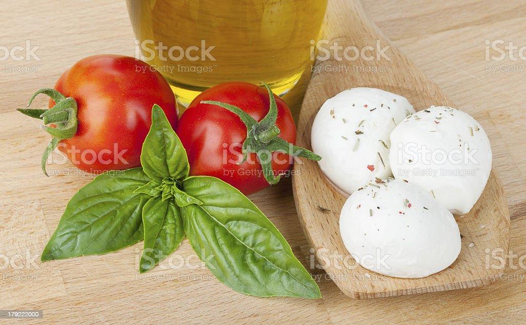 Mozzarella, olive oil, tomatoes and basil royalty-free stock photo